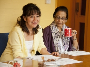 two women with a poem drinking tea