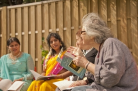 Four women talk about The Unforgotten Coat outdoors