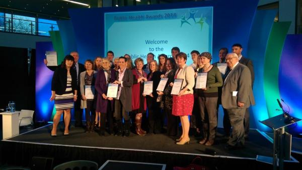 Jennifer McDerra, The Reader Organisation's Development Manager for Public Health and Dementia, accepts the Wiltshire Public Health award for improving mental health and wellbeing, awarded to the Wiltshire shared reading project (Photo credit: Wiltshire Council)