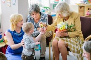 Little boy receives flower from The Duchess