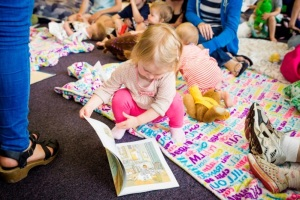A child at a 'Tiny Reads' shared reading group, hosted by The Reader Organisation at Calderstones Park